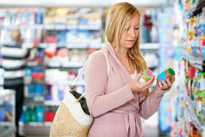 woman shopper comparing two products